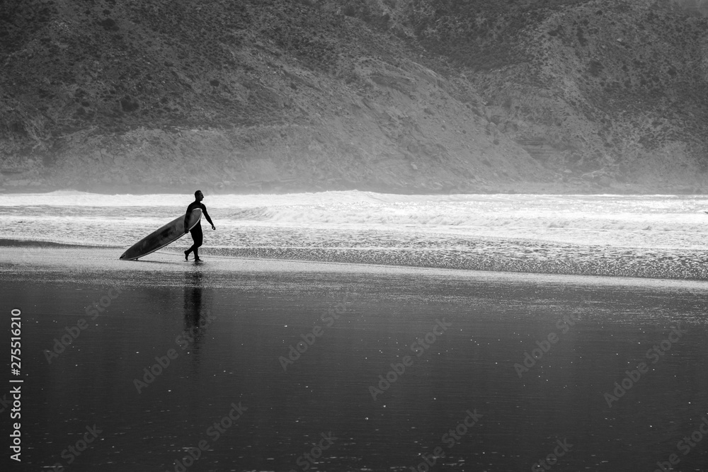 Fototapeta Silhouettes of surfers on the shores of the Atlantic Ocean. Beach in the suburbs of Agadir. Africa Morocc