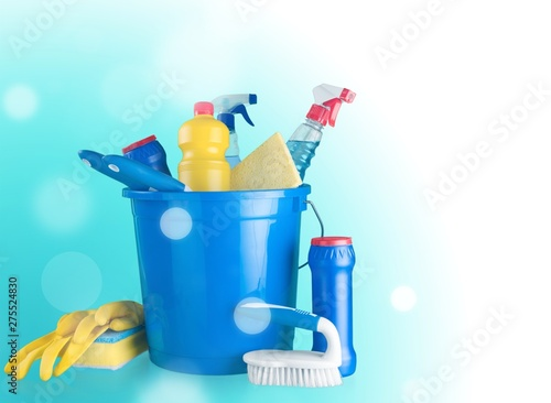 Plastic bottles, cleaning sponge and gloves on background