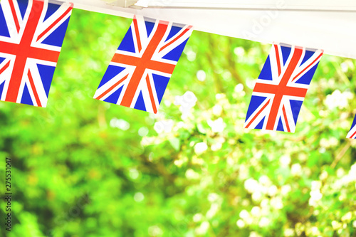 Union jack British flags bunting in summer garden party tent Canvas Print