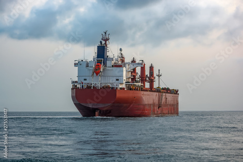 Bulk carrier vessel is awaiting loading of bauxite ore at outer anchorage of Kamsar port, Guinea, West Africa Wallpaper Mural