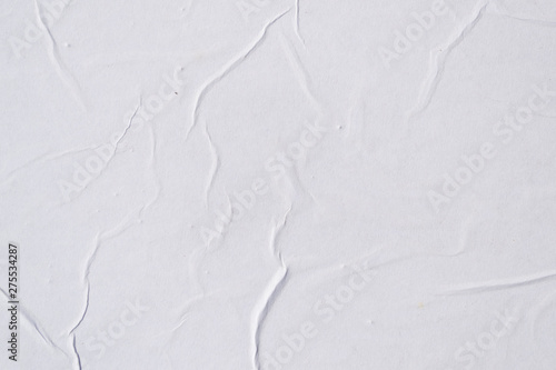 Foto op Plexiglas Wand White creased poster texture. Abstract background.