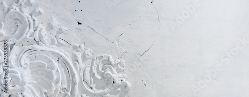 Fotografering  Elements of architectural decorations of buildings inside on the ceiling, gypsum stucco, wall white texture, plaster old ornaments and patterns, vintage, cracked, Baroque