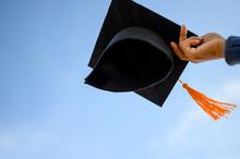 Graduates Hold A Black Hat Wit...