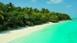 Flight along an exotic island towards a jetty in turquoise water. Barbados. Dolly in