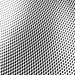 Abstract halftone texture of black dots on white background.