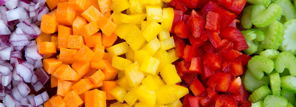 Fototapety, obrazy: Top view, chopped fresh vegetables (carrot, celery, red onion, peppers) arranged on a cutting board. Overhead view, from above, flat lay.