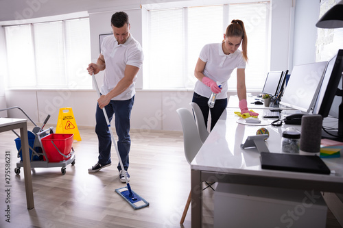 Smiling Two Young Janitor Cleaning The Office - 275586231