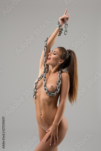 Naked girl with thick metal chain shot