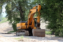 Excavator Parked In Shade Of L...