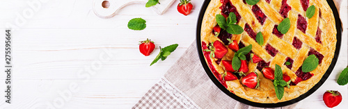 Keuken foto achterwand Brood American strawberry pie tart cake sweet baked pastry food on white wooden table. Banner. Top view