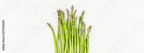 Fresh green asparagus on white wooden background Canvas Print