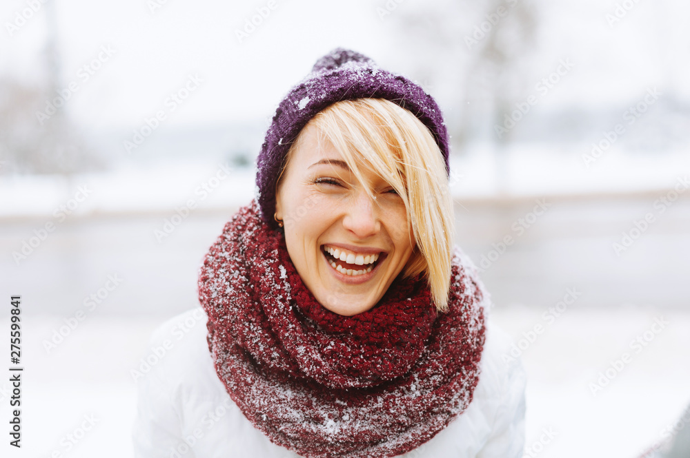 Fototapety, obrazy: A young woman is laughing outside, in winter.