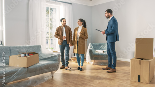 Poster Ecole de Danse Professional Real Estate Agent Shows Bright New Apartment to a Young Couple. Successful Young Couple Ready to Become Homeowners. Spacious Bright Home with Big Windows.