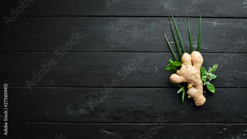 Fotografie, Obraz  Fresh ginger on a black background. Top view.