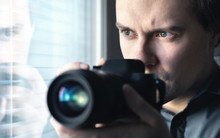 Private Detective, Undercover Cop, Investigator, Spy Or Paparazzi With Camera Taking Photos. Agent Or Police Spying, Investigating Or Following People. Espionage Or Surveillance Concept. Man Hiding.