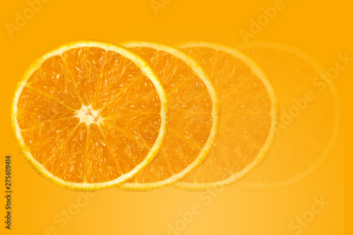 Photo Stands Slices of fruit background of half cut orange on orange background