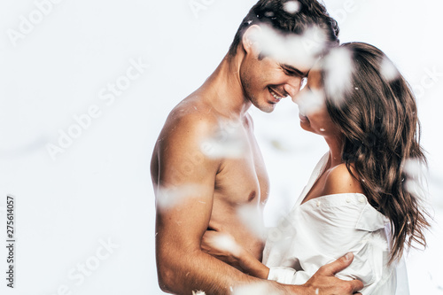 Obraz Affectionate young couple with feathers - fototapety do salonu