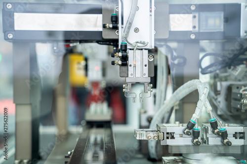 Carta da parati  automation machine and detail close up in machine automatic with robotic automat