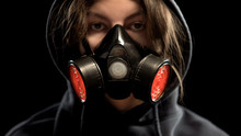 Female In Respirator On Dark Background, Protection From Gas Attack, Closeup