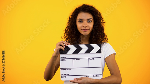 Attractive black woman holding clapper board, film studio, actor audition, clip Canvas Print
