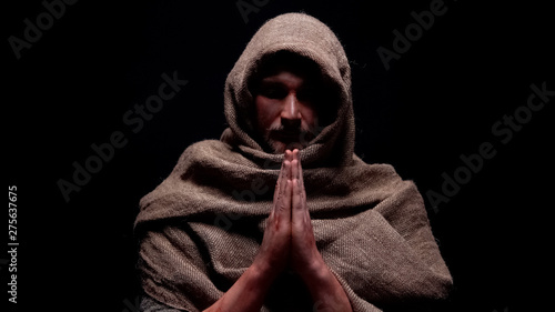 Photo Christian prophet in robe praying, asking for soul salvation, belief in god