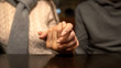Young man holding female hand, togetherness and support in relations, close-up