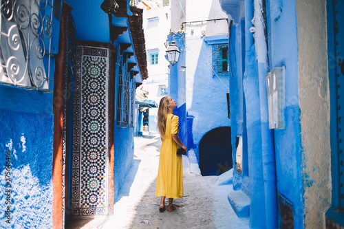 Beautiful girl with amateur camera standing in tourists city - Morocco inspectin Wallpaper Mural