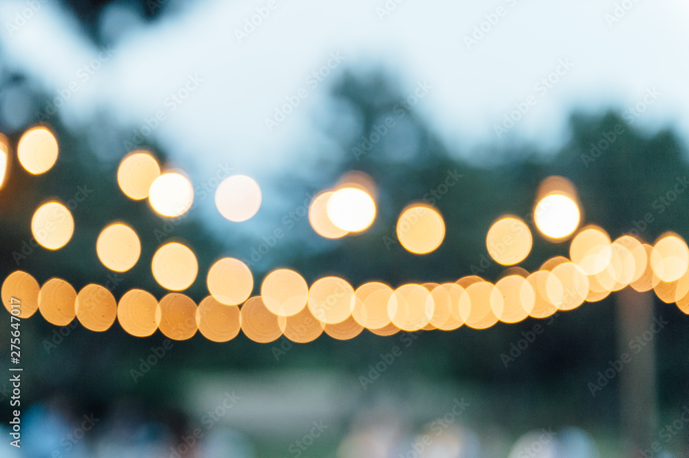 Fototapety, obrazy: Light bulb decor in outdoor party. blurred photo