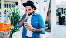 Young Turkish Man Open Received Email With Virus Content Feeling Frustrated From Making Online Mistake On Cellphone Gadget, Spanish Hipster Guy Forget Installing Application For Offline Communication