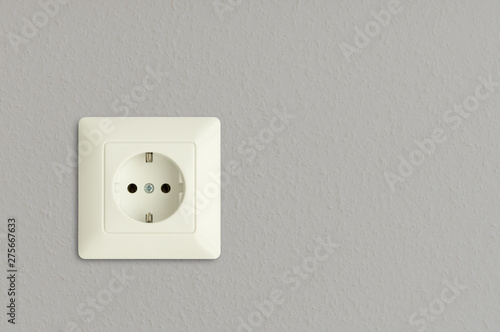 Fotografiet electric outlet on grey wall, electrical socket on gray background