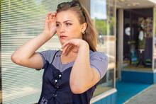 Cute Teenage Girl Posing On Sidewalk