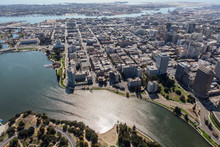 Aerial View Of Lake Merritt And Downtown Oakland Buildings And Streets In California.