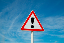 Exclamation Point Of Attention Against The Sky. Triangular Sign. Danger, Warning.