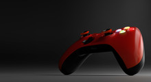 Red Video Game Controller Isolated On Darkness Background