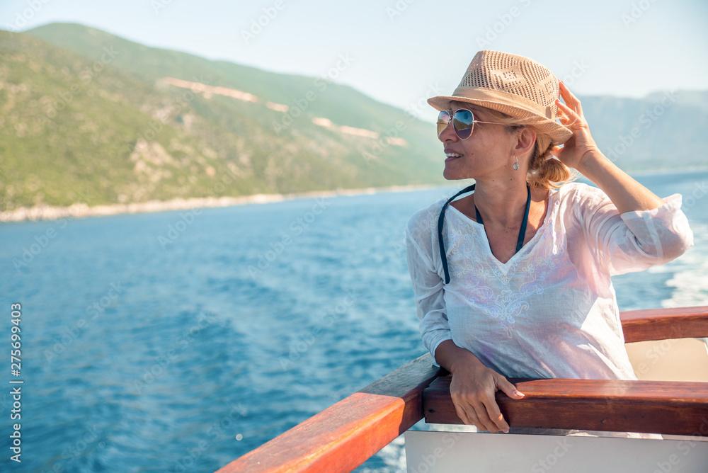 Fototapety, obrazy: Happy woman enjoys the beach on a sunny day