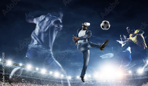 Virtual Reality headset on a black male playing soccer - 275704205