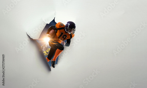 Photo  Paper breakthrough hole effect and american football