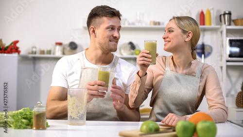 Positive couple toasting fresh green smoothie, healthy lifestyle, antioxidant Canvas Print
