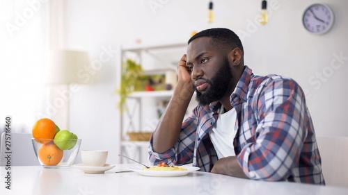 Fotografia African-American man having no appetite, eating disorder, depression problem