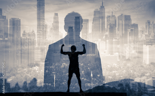 Finding your inner strength. Strong determined man in the city. Fototapeta