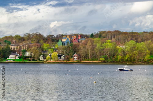 Typical landscape scenery with houses and a boat in Lloyd Harbor in Long Island Wallpaper Mural