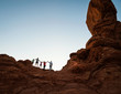 Family enjoying hiking and holding hands at sunset in Moab, Utah