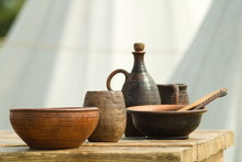 Medieval Earthenware On A Wooden Table In A Viking Campground