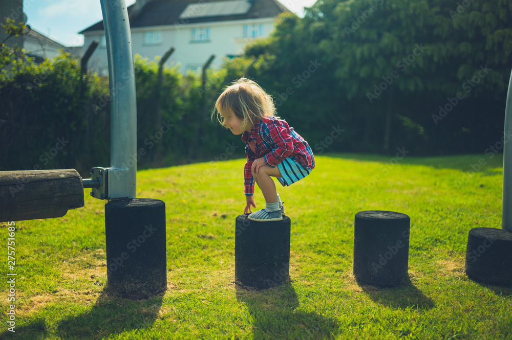 Fototapety, obrazy: Little toddler balancing at the playground