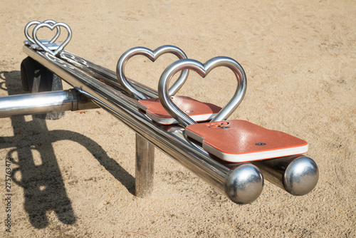 Photo  See-saw with a heart-shaped knob in children playground.
