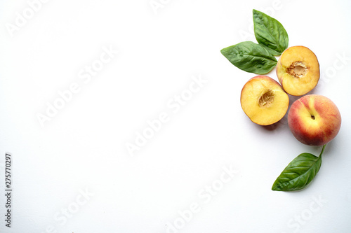Summertime fruit layout made of sweet ripe peaches on white background. Healthy food, delicious dessert - 275770297