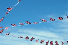 English Flags Against A Blue Sky