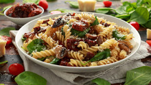Fusilli Pasta With Sun Dried Tomatoes, Mushrooms, Parmesan Cheese And Spinach. Healthy Food.