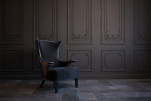 Stylish Black Chair Against A Dark Gray Wall