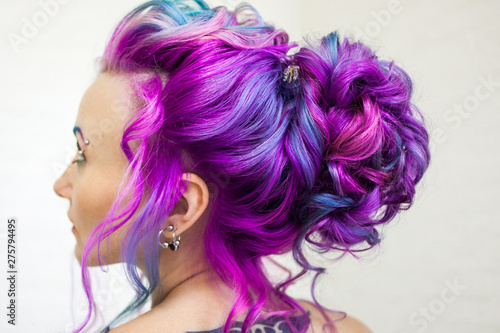 Delightfully bright colored hair, multi-colored coloring on long hair. An elegant high hairstyle